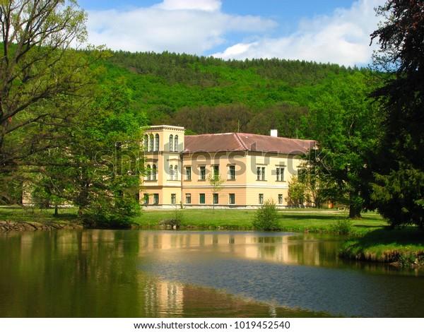 Chateau in Bohemia pod Kosíøem in the Czech Republic in a forested hill