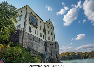 Orlík Chateau in central Bohemia with surrounding trees and river Vltava