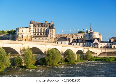 Chateau d'Amboise on the river Loire, France. This royal medieval castle located in Amboise town is a famous tourist attraction. Scenic panoramic view of the old French landmark in summer.