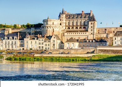 Chateau d`Amboise in summer, France. This royal castle located in Amboise city in the Loire Valley is an old French landmark. Sunny panorama of Amboise on the river bank. UNESCO World Heritage Site.