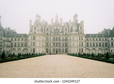 Chateau de Chambord, France - Nov 2018 : Chateau Chambord during autumn and foggy day by lomography 800 film