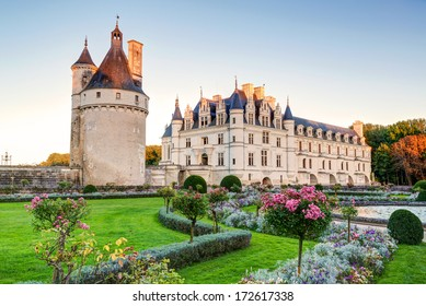Chateau de Chenonceau in evening, the Loire Valley, France. It is a famous travel destination in Europe. Beautiful scenic view of the old castle with flower garden. UNESCO World Heritage Site.