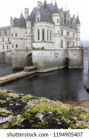 Chateau de Chenonceau,  Loire Valley, France - December 30, 2016: Frosty and foggy winter day does not stop tourists from visiting the chateau. View from the garden.