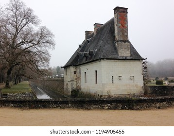 Chateau de Chenonceau,  Loire Valley, France - December 30, 2016: Frosty and foggy winter day does not stop tourists from visiting the chateau. Small building at the entrance to the estate.