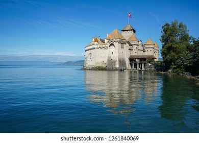 Chateau de Chillon Castle and mountains. It is a medieval fortress on Lake Geneva (Lac Leman), near Montreux, canton of Vaud, Switzerland