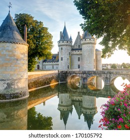 Chateau de Sully-sur-Loire in summer, France. This Gothic castle is located in the Loire Valley and is one of the main travel attractions in the world. Mirror reflection of an old fortress in a lake.
