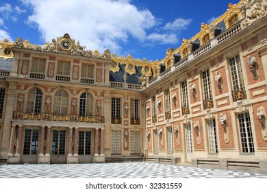 Chateau de Versailles under blue cloudy sky