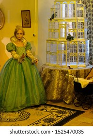 """Chateau d'Usse, France - April 25, 2018: Princess Aurora, a wax figure from the fairy tale """"Sleeping beauty"""" in the Chateau d'Usse."""