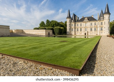 Chateau Pichon-Longueville with towers, garden and great green lawn in the city of Pauillac in Medoc in France.