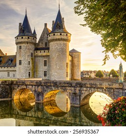 Chateau of Sully-sur-Loire  in sun light, France. This medieval castle located in the Loire Valley is European landmark. Beautiful sunny view of Sully-sur-Loire castle with bridge at sunset.