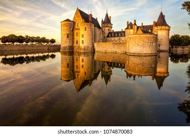 The chateau of Sully-sur-Loire at sunset, France. Castle is located in the Loire Valley. Sully-sur-Loire, France.