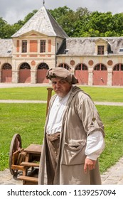 CHATEAU VAUX-LE-VICOMTE, MAINCY, FRANCE - June 17, 2018: An actor in the costume of a 17th Century cattle herder greets a visitors and tells stories to visiting children in the castle's courtyard.