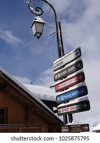 CHATEL, FRANCE - FEB 12, 2018 - Signpost with directions to neighboring towns  in small alpine village of Chatel, France