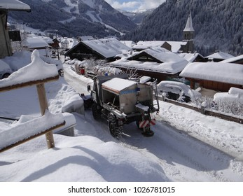 CHATEL, FRANCE - FEB 12, 2018 - Snowplow working to remove snow from streets of Chatel, France
