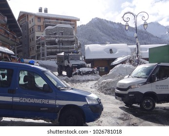 CHATEL, FRANCE - FEB 12, 2018 - Snowplow and poice car on streets of Chatel, France