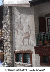 CHATEL, FRANCE - FEB 12, 2018 - Chamois painting on side of building in alpine village of Chatel, France