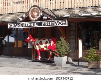 CHATEL, FRANCE - FEB 20, 2018 - Fancy cow statue selling charcuterie and cheese in small alpine village of Chatel, France