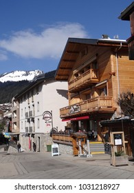 CHATEL, FRANCE - FEB 20, 2018 - Skiers having lunch outdoors at a restaurant in small alpine village of Chatel, France