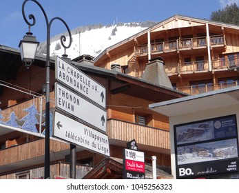 CHATEL, FRANCE - FEB 20, 2018 - Signpost with directions to neighboring towns  in small alpine village of Chatel, France