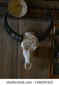 CHATEL, FRANCE - FEB 20, 2018 - Carved skull and horns decorate a rerstaurant in small alpine village of Chatel, France