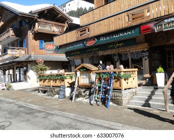 CHATEL, FRANCE - FEB 24 - Skiers leave their skis against the fence   while they stop for lunch  Chatel, France