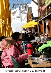 CHATEL, FRANCE - FEB 27, 2012 - Skiers enjoy lunch outdoors in the sun   at the tiny village of Les Lindarets  in the Portes du Soleil, France
