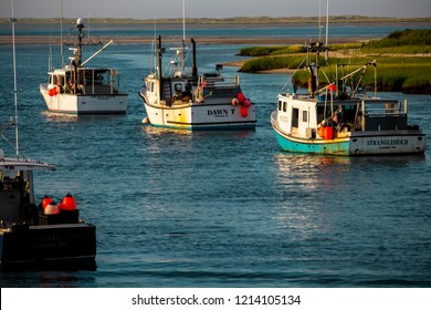 Chatham Harbor, Massachusetts USA: July 20th 2018. Commercial fishing boats are moored in Chatham Harbor, Massachusetts in the late afternoon sun.