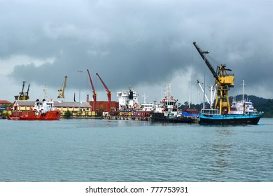 CHATHAM ISLAND, PORT BLAIR, ANDAMAN ISLANDS, INDIA,  DECEMBER 19, 2017: View of the Harbor from Chatham Saw mill. Ships, boats and cranes were used to transport timber from Chatham island.