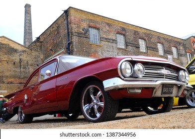 Chatham, Kent / UK - 04/22/2019: 1960 Chevrolet Biscayne sedan in front of No 1 Smithery at 2019 Festival of Steam & Transport at Historic Dockyard.