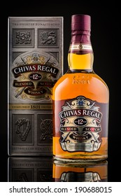 CHATHAM, NJ, UNITED STATES - MAY 4, 2014: Chivas Regal box and whisky bottle. Chivas Regal is the market-leading scotch whisky 12 years and above in Europe and Asia Pacific.
