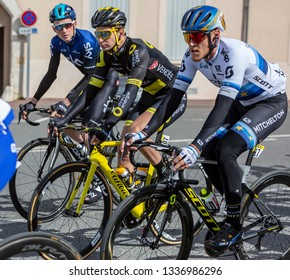 Chatillon-Coligny, France - March 10, 2019: Three cyclists (Matteo Trentin, Anthony Turgis,Tao Geoghegan Hart) riding in the peloton, in Chatillon-Coligny during the stage 3 of Paris-Nice 2019.
