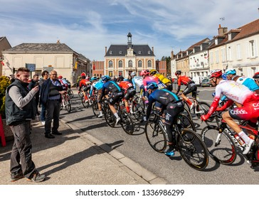 Chatillon-Coligny, France - March 10, 2019: The peloton riding in front of the City Hall in Chatillon-Coligny  during the stage 3 of Paris-Nice 2019.
