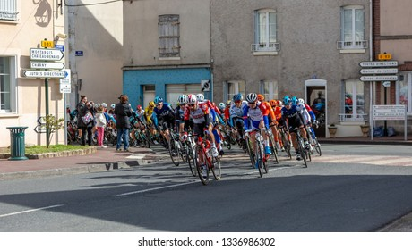 Chatillon-Coligny, France - March 10, 2019: The peloton riding in Chatillon-Coligny during the stage 3 of Paris-Nice 2019.