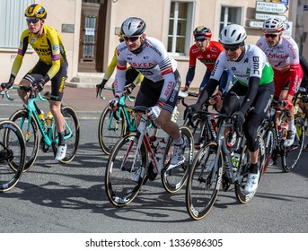 Chatillon-Coligny, France - March 10, 2019: Three cyclists (Andre Greipel , Lars Ytting Bak, Mike Teunissen) riding in the peloton, in Chatillon-Coligny during the stage 3 of Paris-Nice 2019.