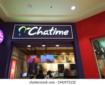 Chatime Store Front with Logo and TV Screens. Chatime is a Taiwanese tea brewer with more than 50 different flavors.  Jakarta, Indonesia - March 2021