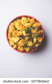 Chatpate Masala Aloo Sabzi fry OR Bombay potatoes served in a bowl, selective focus