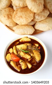 Chatpate Masala Aloo Sabzi fry OR Bombay potatoes served with fried puri or Indian bread