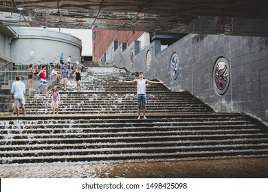 Chattanooga, Tennessee/USA- August 2019- People playing on the water steps in downtown Chattanooga.