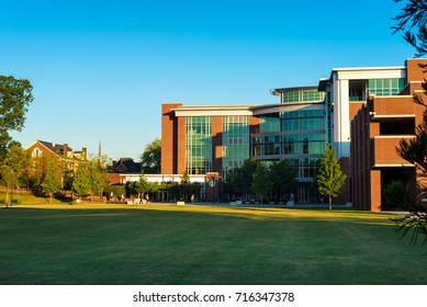 CHATTANOOGA, TN - AUGUST 24, 2017: Students walk to early classes in front of the Library on the campus of the University of Tennessee Chattanooga.