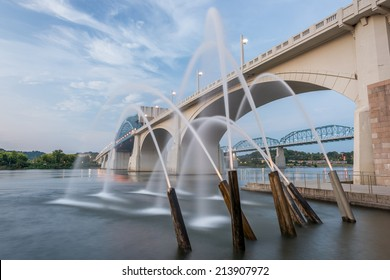 CHATTANOOGA, TN/USA - AUGUST 29: Riverfront fountains and evening street lights with a partly cloudy sky at Ross's Landing on 29th of August 2014 in Chattanooga.