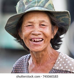 Chau Doc, Mekong Delta, Vietnam- October 25, 2012:Old woman on the market of Chau Doc. She smiles and shows her teeth