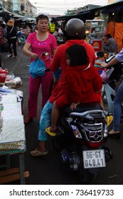 CHAU DOC, VIETNAM - FEB 7, 2015 - Family on a motorbike in the market Of Chua Phuoc An, Vietnam