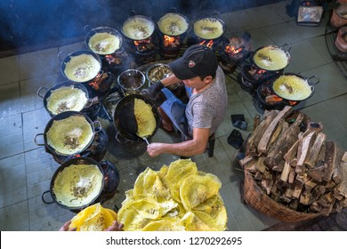 Chau Doc, Vietnam - Oct 13, 2018: Vietnam man cooking Banh xeo (sizzling cake), Vietnamese traditional street food yellow crispy rice flour cake
