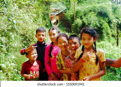 Chaubas / Nepal - October 2017: Joyous, colorful, happy Nepalese children. Boys and girls smiling, laughing in the heart of nature. Traditional clothes.