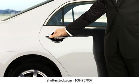 Chauffeur hand opening car door
