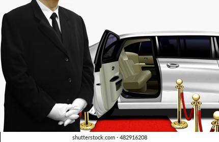 Chauffeur waiting by the white limousine