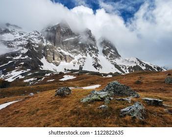 Chaukhi Mountain in clouds. Caucasus, Georgia