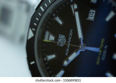 Chaux-de-Fonds, Switzerland, August 21 2019 - The close up of Tag Heuer Aquaracer steel black mecanical watch, a famous swiss made luxury wrist watch from Switzerland manufacturing clock company