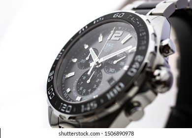 Chaux-de-Fonds, Switzerland, August 21 2019 - The close up of Tag Heuer Formula 1 Aquaracer steel black mecanical watch with black face, swiss made luxury wrist watch from Switzerland manufacturing