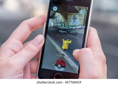 CHAVILLE, FRANCE - JULY 24: Apple iPhone5s with Pikachu from Pokemon Go application, hands of a teenager playing on the day of the launching of the game in France, on July 24, 2016 in Chaville France